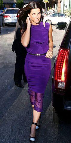 Sandra Bullock in Prabal Gurung Prabal Gurung Pre-Fall 2013 purple sheath dress with a draped bodice, shoulder loop detail and organza double hem at 'The Heat' Boston Premiere. June 21, 2013