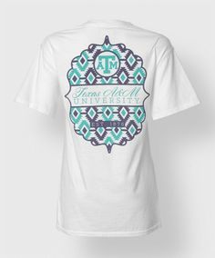 """This comfort colors shirt has a breast pocket with a teal ATM in a purple circle. The back features a purple and teal tribal design and reads """"Texas A&M University, Est. 1876"""""""