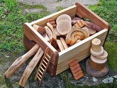 Box of assorted wooden shapes. oh the possibilities.