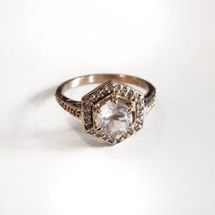 18ct yellow gold hex engagement ring set with a rose quartz and surrounded by white diamonds by Meadow Lark Jewellery