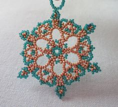 Browse unique items from LescreationsAlepine on Etsy, a global marketplace of handmade, vintage and creative goods. Snowflake Wreath, Ornament Wreath, Beaded Earrings Native, Snow Flakes Diy, Crystal Snowflakes, Beaded Ornaments, Wooden Beads, Bead Weaving, Bead Crafts