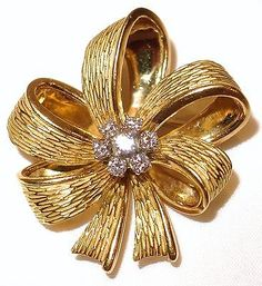 Vintage Tiffany & Co. Brooch 18 K Solid Yellow Gold Bow Seven Diamonds.