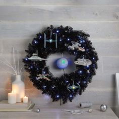 Star Galaxy Black Wreath With Lights, 30 Aim for the stars with this cool Star Galaxy Wreath. Artificial pre-lit wreath in deep space black features bright white LED lights for displaying sci-fi or Halloween ornaments. Star Wars Christmas Tree, Diy Christmas Lights, Black Christmas Trees, Christmas Diy, Christmas Tree Wreath, Disney Christmas Decorations, Christmas Themes, Disney Christmas Crafts, Regalos Star Wars