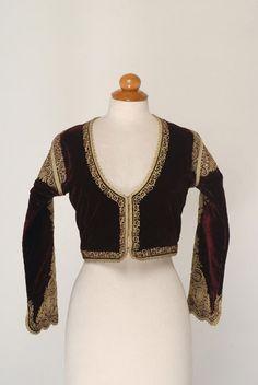 Βελούδινο ζιμπούνι, είδος κοντού μανικωτού επενδύτη, εξάρτημα της γυναικείας νυφικής μεγαρίτικης φορεσιάς.