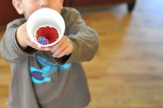 Balloon cup shooters- make your own pom poms to shoot (using a fork!).