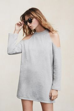 Give 'em the cold shoulder. No, really. The Oracle Dress is a great way to show off your other upper assets and stay cozy at the same time. This is a mock neck sweatshirt dress with open shoulders, long sleeves and a mini length.  https://www.thereformation.com/products/oracle-dress-concrete?utm_source=pinterest&utm_medium=organic&utm_campaign=PinterestOwnedPins