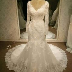 You can have long sleeve wedding dresses like this v-neck lace design made with any changes.  We can also make inexpensive #replicas of designer wedding dresses for you too.  Get pricing on our designs or on any dress in a picture you love from the internet when you contact us directly.