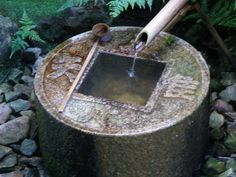 """Stone washbasin for Japanese garden. This one is located at Ryo-an ji Temple in Kyoto. Four Chinese characters expressing the philosophy of Zen, """"Know enough."""" my favourite phrase."""
