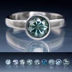I love blue diamonds. Blue/ Green Montana Sapphire Bezel Set Engagement Ring | Nodeform