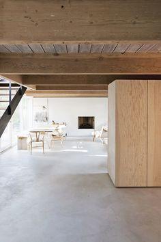Dining room with concrete floor. Scott & Scott