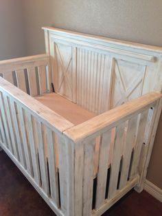 "The Rustic Acre Baby Bed. ""x"" and Bead board details. 3-1 convertible bed."