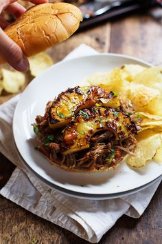 Grilled Pineapple Pork Sandwiches - juicy shredded slow cooker pork with caramelized pineapple pieces. | pinchofyum.com