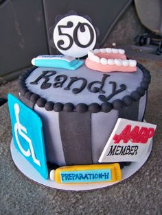 50th birthday cake complete with dentures, Fixodent, and an AARP card- for dad's 60th??@Katie Johnson