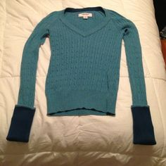 American Eagle Outfitters Cable-knit sweater Color: turquoise blue with navy blue cuffed up sleeves. The sleeves are log which is nice for girls like me who have long arms!! A very classic sweater! American Eagle Outfitters Sweaters
