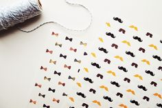 Free Printable Moustache and Bow Wrapping Paper by Design is Yay!