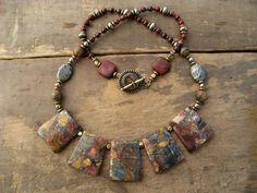 Necklace | Karen Daugherty.  Picasso jasper, iron pyrite and brass