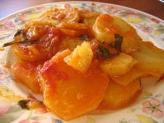 Stewed potatoes with tomato sauce