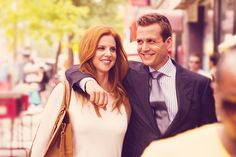Donna Paulsen (Sarah Rafferty) and Harvey Specter (Gabriel Macht). Look at how perfect they are damn it.