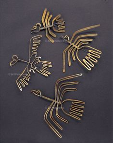 "Brooches | Alexander Calder. ""Birds"" Brass and steel wire. ca. 1940 = 1945. 