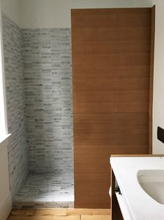 Carrara Marble With Wood Accent Wall