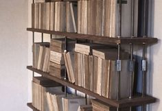 The Volterra Bookcase, designed for containing precious volumes, is made using Italian prime materials, of rare and exclusive provenance. It unites seasoned, rooted oak with two other high quality components: a set of bookends in Volterra alabaster to protect ones more delicate volumes and a board in excavated slate.
