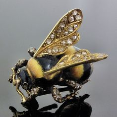 A Victorian metal, enamel and diamond brooch in the form of a bee
