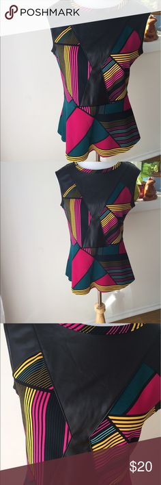 Leather Trim Sleeveless Peplum Adorable for the office. Bright sleeveless peplum with faux leather details. Can be worn under a blazer or alone. Sleek office look! NWT Worthington Tops