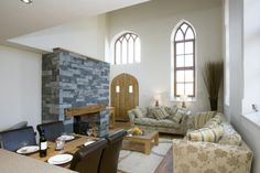 A luxurious, contemporary chapel conversion - a great holiday home to stay in at any time of the year. Capel Tabernacl has under floor heating and a wood burning stove make it a lovely snug, relaxing cottage to stay in in the winter. Morfa Nefyn is a small seaside town on the glorious Lleyn Peninsula, North Wales. The coastline is dramatic and the scenery is astonishingly beautiful with sandy beaches and pretty coves. Sleeps 4.