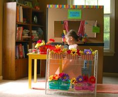 Most adorable cardboard flower shop EVER. Awesome post on ways to be creative with your kids!