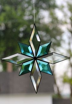 Stained glass bevel star by Barbara's Glassworks.