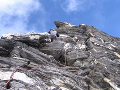 Climbing Pokalde Peak, partner Ganesh leads with rope to the summit; Nepal Himalayas