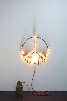 Marc Bijl - Burning Peace Metal peace sign with small gass cilinder, ∅ 100 cm, Dimension variable, Edition of 4+ 1AP