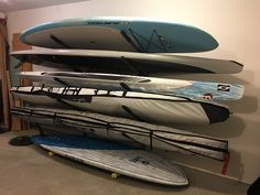 Got a lot of paddleboards? Try out this 5 SUP storage rack- holds up to 5 SUPs all in one place! #garagestorage #supstorage #storeyourboard