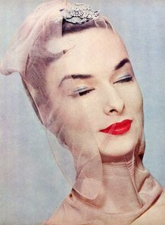 "Model Rose-Marie wearing rose diamond brooch by Van Cleef & Arpels, Hudson nylons, Germaine Monteil lipstick, photo in the ""surreal"" style by Erwin Blumenfeld, 1954"