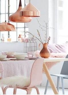 Once again the copper fixtures and pink accents in the kitchen