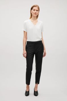COS image 1 of Tailored slim-fit trousers in Black