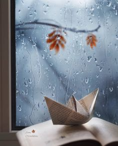 Paper boat on book in front of rainy window Rainy Mood, Rainy Night, Night Rain, Rainy Morning, Rain Wallpapers, Cute Wallpapers, Rain Photography, Creative Photography, Rainy Day Photography