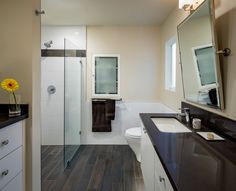 Curbless / seamless shower with same shower floor tile as rest of bathroom (thought this was one of reasons you did these seamless showers besides the universal design aspect)  HouseWorks Design Build Remodel Santa-Ana-Bathroom-Remodel