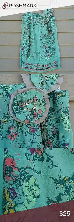 Anthro top Beautiful feminine Anthropologie Lulumari top, absolutely gorgeous excellent condition has been gently worn the only thing is one of the flowers are loose but still intact,  can be easily fixed (See last picture) size M with stretchy waist Anthropologie Tops