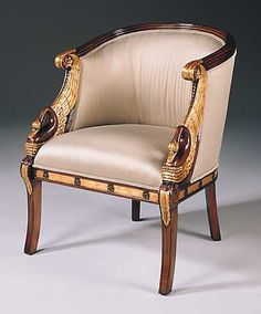 Hand carved mahogany empire armchair, with gold metal leaf swan accents and moire upholstery. Dimensions (W x D x H) 28 x 25 x 34 inches