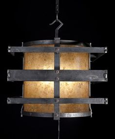 Circular drum light framed by a square to enhance linear structure