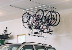 Bicycle storage ideas fitnessworkout co monkey bars 3 bike rack clug hide a garage ceiling bike storage ceilings bike ceiling mount storage rack Bicycle Storage [. Bicycle Storage Garage, Bike Storage Rack, Garage Bike, Garage Storage, Garage Organization, Garage Doors, Bike Storage Solutions, Storage Ideas, Best Bike Rack