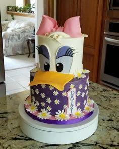 Daisy Duck Cake for my Goddaughter Daizi's 1st Birthday! Happy Birthday Daizi! #okccakelady #customcakesinokc #cakedecoratorinokc #oklahomacakedecorator #customcakesofoklahoma #ilovemycustomers #bestcustomers #mylife #therealokccakelady #shoplocalokc #okcgroomscakes #bakinandcakin #daisyduck #daisy #disney #1stbirthday
