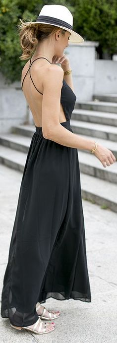In love with this black Chiffon open back maxi dress. Styling it with the fedora hat is a cute idea! #dress #fashion
