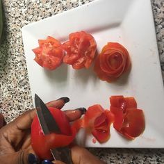 The process of vegetable carving. This is just a regular table knife. It's not even a carving knife yet it cuts with such precision. Here is a student making her way through tomatoe roses.... #cheflife #chefstalk #chefsofinstagram #chefs #WhoWantsToEat #watwedo #fitfam #cuisine #vscofood #vscocam #vsco #cnnafrica #proudlynigeria #madeinlagos #iphonephotography #iphone6 #eats #vscopicture #truecooks #theartofplating by freesiafoodie