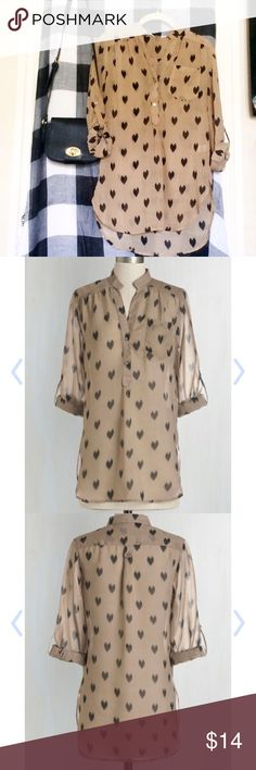 """Modcloth Love Ballad Tunic, Tan size S Sheer Modcloth tunic with adorable heart print. Looks adorable with black cami and leggings, or tucked into a highwaist skirt or pants! Tab at sleeves with button to adjust length (they look cutest cuffed!). Handwash, 100% polyester. 29.5"""" length. **Tiniest of tears at front button placket (pictured). ModCloth Tops Tunics"""