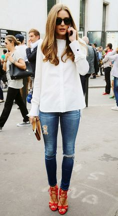 Olivia Palermo and white shirt + ripped and frayed skinny jeans and red strappy heels