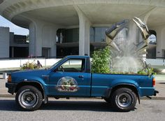 Truck Farm taking a refreshing break in front of the Vancouver Planetarium.