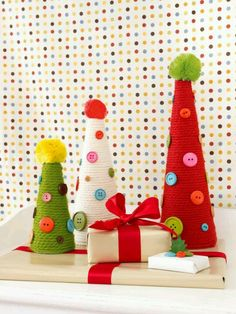 Yarn wrapped Christmas tree cones, embellished with buttons
