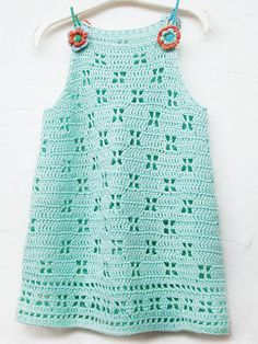 This cute summer dress is made using all double crochet and chain stitches with repeating open-work flowers. Size 3 crochet cotton thread or fingering-weight yarn can be used. Slightly thinner/thicker yarn and smaller/larger hook will create differen. Crochet Girls Dress Pattern, Crochet Toddler Dress, Baby Girl Crochet, Crochet Baby Clothes, Crochet For Kids, Crochet Patterns, Annie's Crochet, Booties Crochet, Crochet Hats